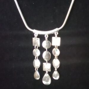 Anne Klein Silver Toned Dangle Charm Necklace.